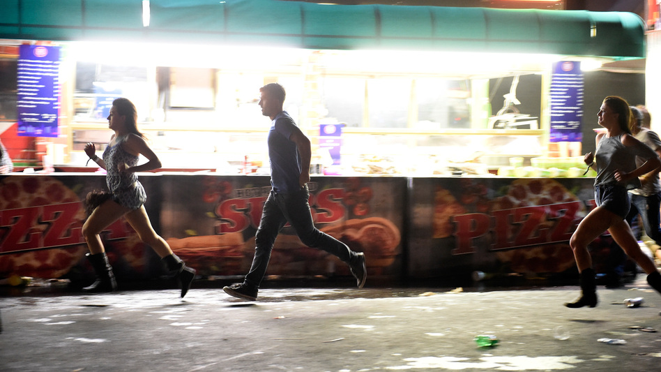 Concertgoers run from the Route 91 Harvest music festival in Las Vegas after the gunfire broke out. By the time the night was over, at least 58 people had died and more than 500 people were wounded in the shooting. (David Becker/Getty Images)