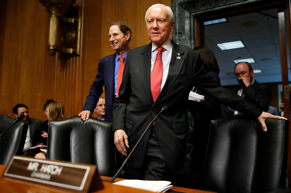 Senate Finance Committee Chairman Orrin Hatch, R-Utah, center, and ranking member Ron Wyden, D-Ore., have a plan to renew funding for the Children's Health Insurance Program, which lapsed Sept. 30. (Jacquelyn Martin/AP)