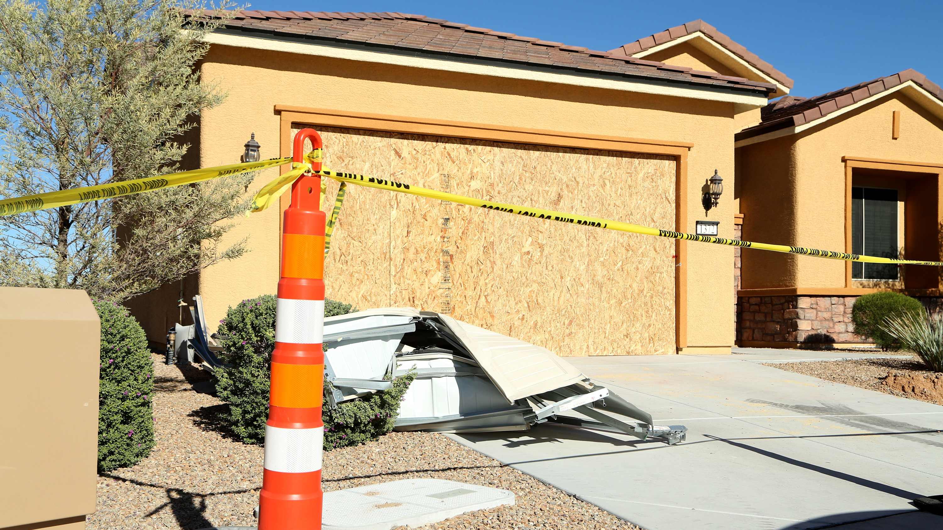 Remains of the garage door sit in the driveway at the house where Las Vegas gunman Stephen Paddock lived in the Sun City community in Mesquite, Nev. (Gabe Ginsberg/Getty Images)
