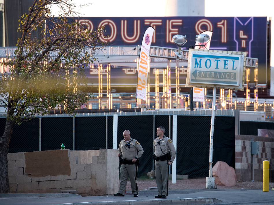 Law enforcement officers stand guard at one of the entrance points to the Las Vegas concert venue where Sunday night's mass shooting took place. The massacre was one of the deadliest mass shooting events in modern U.S. history. (Drew Angerer/Getty Images)