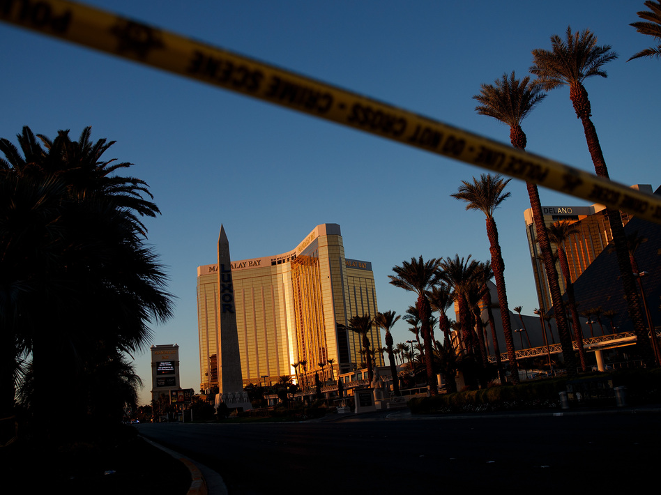 Police tape blocks off part of Las Vegas Blvd. on Tuesday near the scene of a massacre at a country music festival in Las Vegas. Twelve devices known as bump stocks were found in the gunman's room. (Drew Angerer/Getty Images)