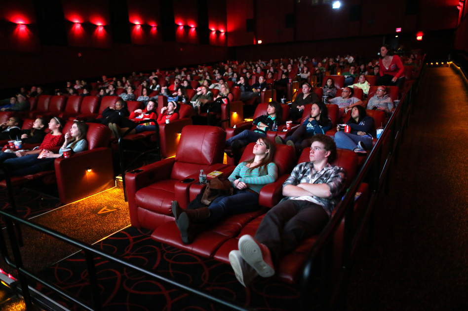 Moviegoers relax in recliner seats at AMC Movie Theater in Braintree, Mass., in 2013. (Jonathan Wiggs/The Boston Globe via Getty Images)