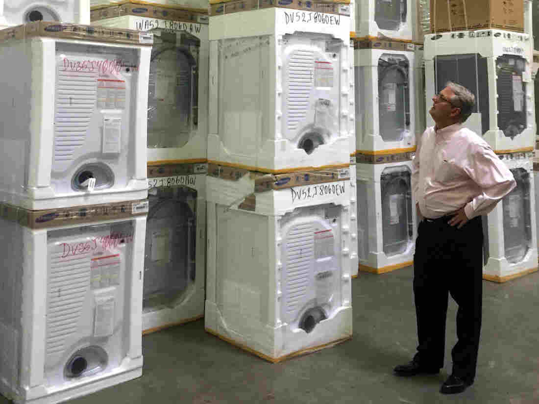 Roddey Player, CEO of Queen City Appliances surveys his stock.