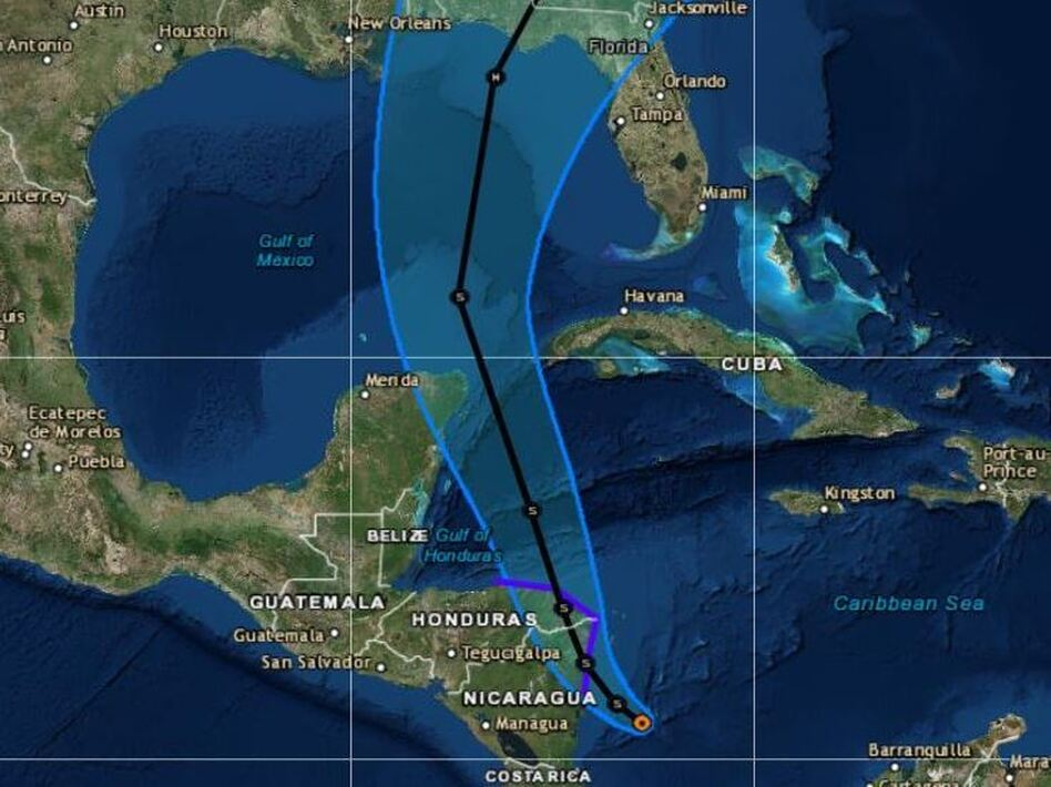 The current forecast track calls for the storm to thread its way between Cancún, Mexico, and the western coast of Cuba. (National Hurricane Center)