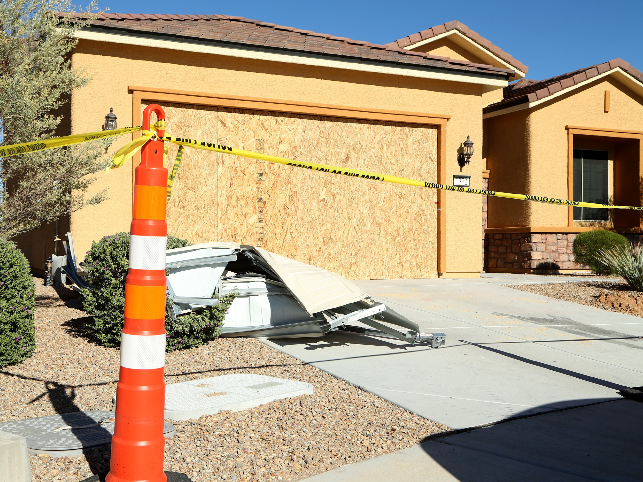 Details emerge of las vegas shooters real estate gambles ncpr news remains of the garage door sit in the driveway at the house where las vegas gunman stephen paddock lived in the sun city community in mesquite nev rubansaba