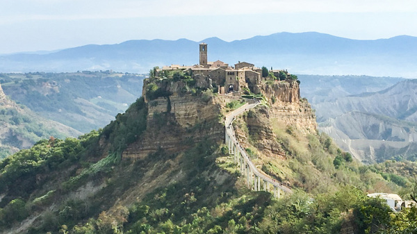 To get to Civita, one must take a long, winding footbridge from the neighboring town of Bagnoregio.