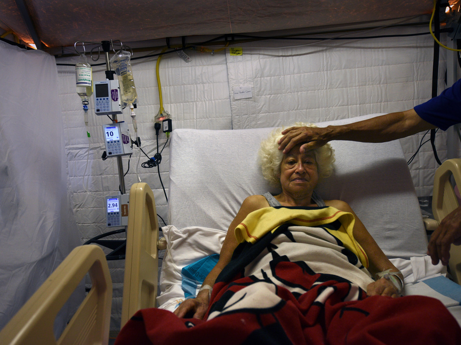 Hospitals in Puerto Rico are dealing with no power, no air conditioning, no local water, no local food, no Internet and very limited communication. (Carol Guzy for NPR)