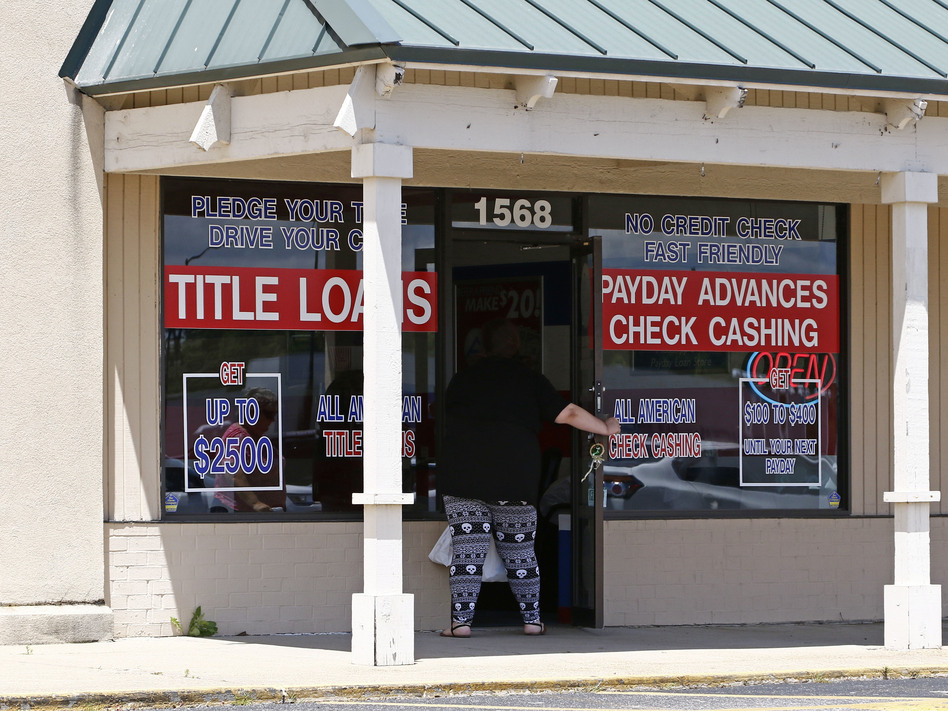 A woman enters an All American Check Cashing location in Brandon, Miss., in May. The Consumer Financial Protection Bureau has proposed new rules to crack down on such lenders. (Rogelio V. Solis/AP)