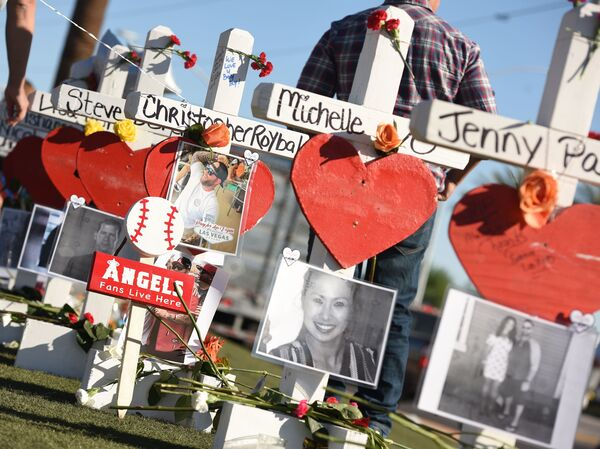 """Some of the 58 white crosses for the victims of Sunday night's mass shooting last Sunday, on the Las Vegas Strip south of the Mandalay Bay hotel on Friday. """"Their names and their stories will forever be etched into the hearts of the American people,"""" Vice President Pence said while visiting the city on Saturday."""