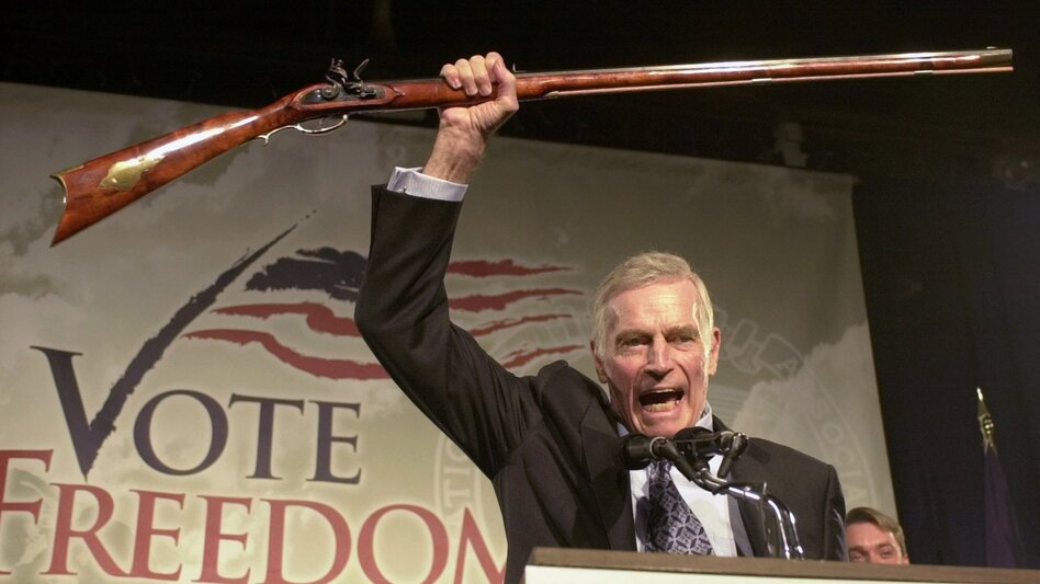 "The late Charlton Heston, the former actor and head of the National Rifle Association, addresses gun owners during a ""get-out-the-vote"" rally in New Hampshire in October 2002. (Jim Cole/AP)"