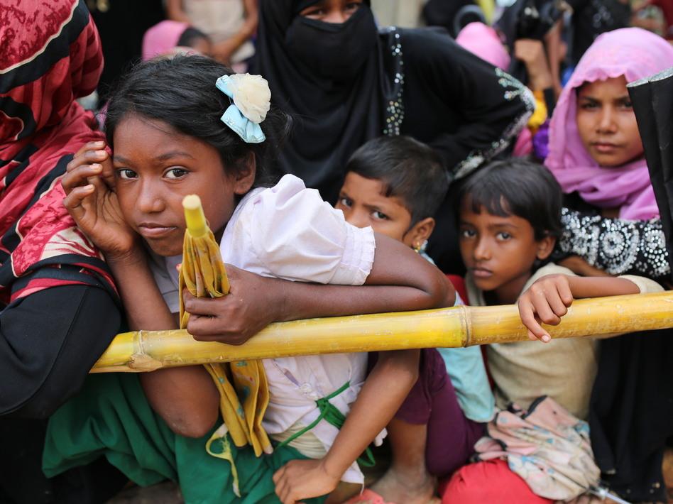 Rohingya children wait for food handouts at Thangkhali refugee camp in Cox's Bazar, Bangladesh, on Thursday. (Zakir Hossain Chowdhury/AP)