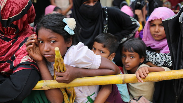 Rohingya children wait for food handouts at Thangkhali refugee camp in Cox