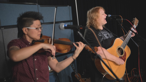 Emily Saliers (right) with Lyris Hung inside the World Cafe performance studio.
