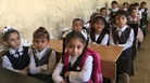 Girls take their seats for the first day of school in Mosul.