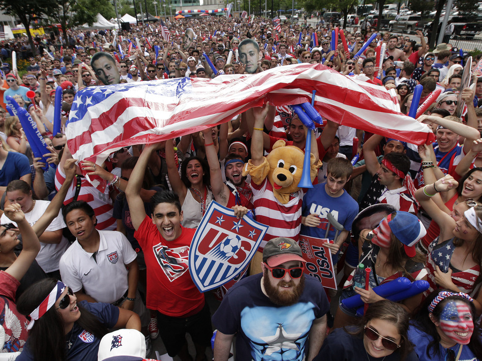 A raucous crowd cheers for Team USA during a Tuesday, July 1, 2014 World Cup soccer match between the U.S. and Belgium at a public viewing party in Detroit, Tuesday, July 1, 2014. For many fans during next year's U.S.-free World Cup, it'll be just another day in the office.