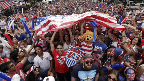 A raucous crowd cheers for Team USA during a Tuesday, July 1, 2014 World Cup soccer match between the U.S. and Belgium at a public viewing party in Detroit, Tuesday, July 1, 2014. For many fans during next year