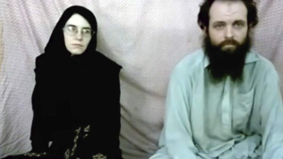 This still image made from a 2013 video released by the Coleman family shows Caitlan Coleman and her husband, Canadian Joshua Boyle, in a militant video given to the family.