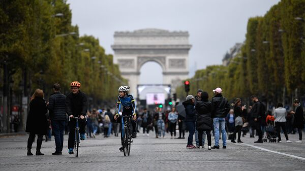 Mayor Anne Hidalgo has called for an end to gas-powered vehicles in Paris by 2030, in favor of biking, transit, and electric cars. Here, cyclists and pedestrians on the Champs- Élysées during the city
