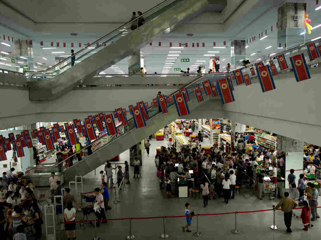This photo taken on July 28, 2013 shows customers shopping at a supermarket in Pyongyang. Chinese yuan, US dollars, euros and tea bags. Money can come in many forms in North Korea, but as a foreign visitor you'll probably never even see a local banknote, let alone use one. AFP PHOTO / Ed Jones (Photo credit should read Ed Jones/AFP/Getty Images)