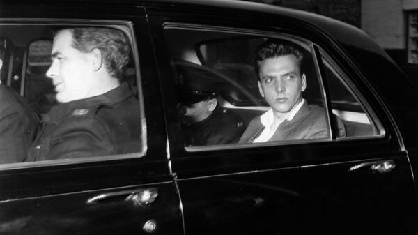 Ian Brady, seen here in police custody prior to a court appearance, was sentenced to life in prison for the Moors murders.