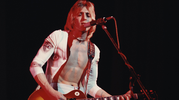 Mick Ronson onstage in 1975. Filmmaker John Brewer hopes his documentary Beside Bowie will earn the late guitarist a place in the rock and roll canon.