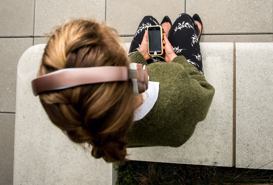She's not tuning in, she's tuning inward — letting go of stress, or at least trying to, with a mindfulness app on her phone. (Photo Illustration by Carolyn Rogers/NPR)