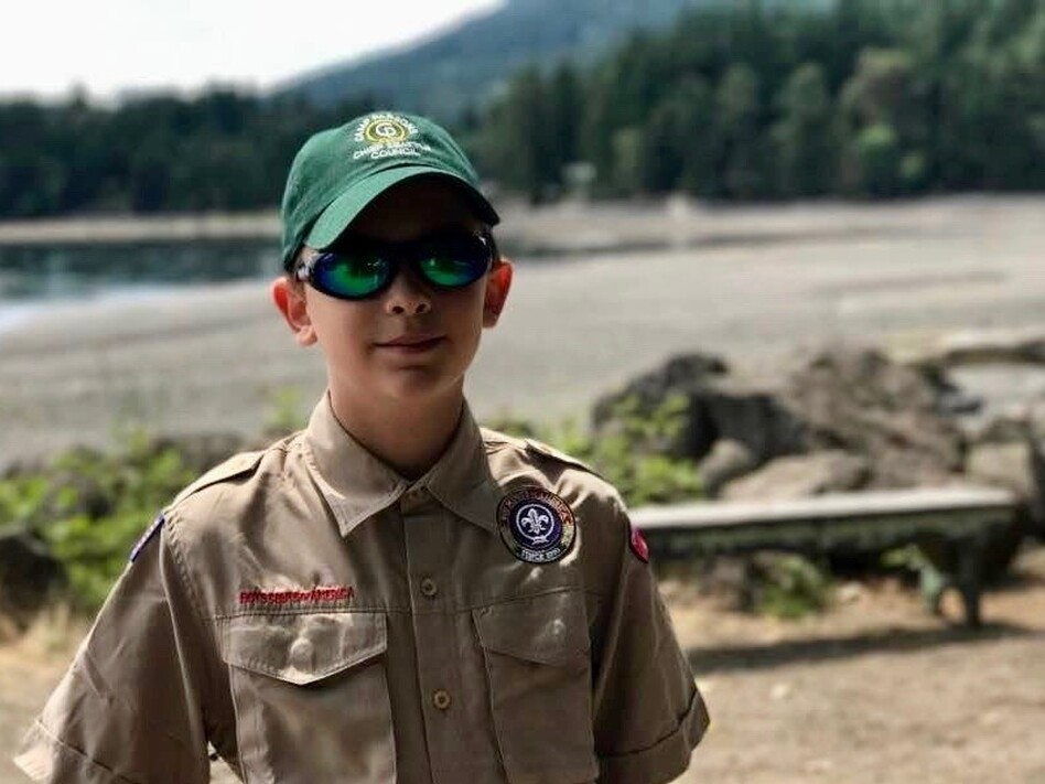 "Boy Scout Charlie Underdown of Seattle says that welcoming girls into the group fits with the Scout Law, which says to be ""trustworthy, loyal, helpful, friendly, courteous, kind, obedient, cheerful, thrifty, brave, clean and reverent."" (Courtesy Perry Underdown)"