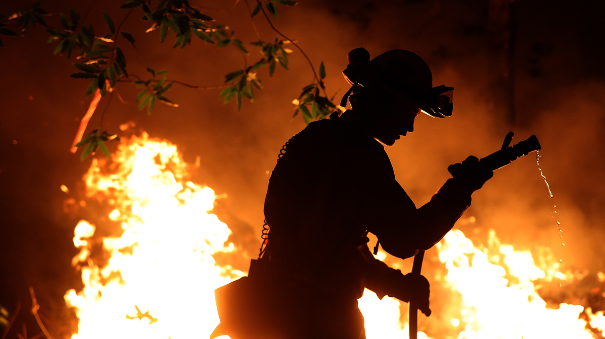 cal fire firefighter trevor smith battles the tubbs fire near calistoga calif on thursday wildfires in northern california have killed dozens of people