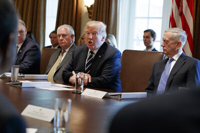 President Trump speaks during a Cabinet meeting at the White House on Monday. (Evan Vucci/AP)