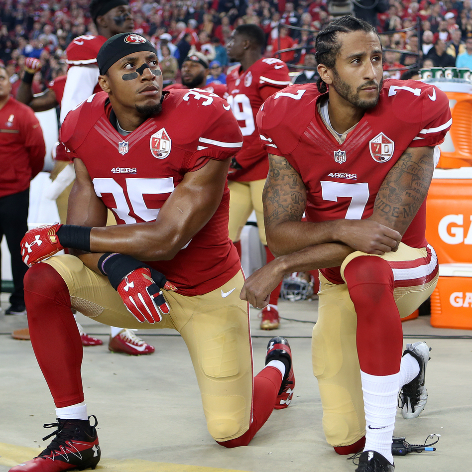 San Francisco 49ers Eric Reid (35) and Colin Kaepernick (7) take a knee during the National Anthem prior to their season opener against the Los Angeles Rams during an NFL football game on Monday, Sept. 12, 2016, in Santa Clara, CA. (Daniel Gluskoter/AP)