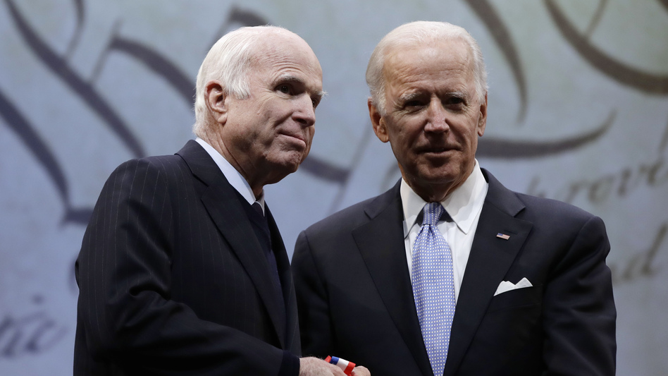 Sen. John McCain, R-Ariz., receives the Liberty Medal from former Vice President Joe Biden, chairman of the National Constitution Center's Board of Trustees, in Philadelphia on Monday.