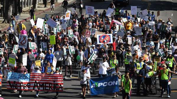 """People marching in the """"#NoMuslimBanEver"""" rally in downtown Los Angeles on Sunday. Organized by the Council on American-Islamic Relations, the march was in response to President Trump's most recent travel ban, which has now been partially blocked by a federal judge in Hawaii."""