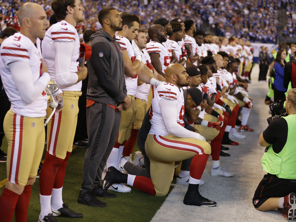 Members of the San Francisco 49ers kneel during the playing of the national anthem before an NFL football game against the Indianapolis Colts, earlier this month. (Michael Conroy/AP)
