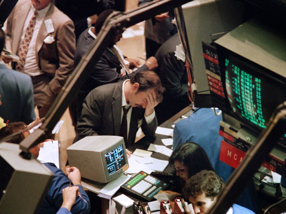 A trader at the New York Stock Exchange reacts on Oct. 19, 1987, when the Dow Jones industrial average plunged more than 22 percent — the biggest single-day drop in history. (Maria Bastone/AFP/Getty Images)