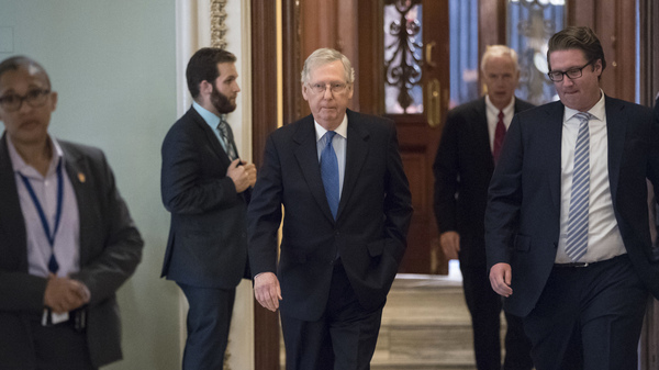 Senate Majority Leader Mitch McConnell, R-Ky., walks from the chamber to his office during a long series of votes at the Capitol in Washington, on Thursday.