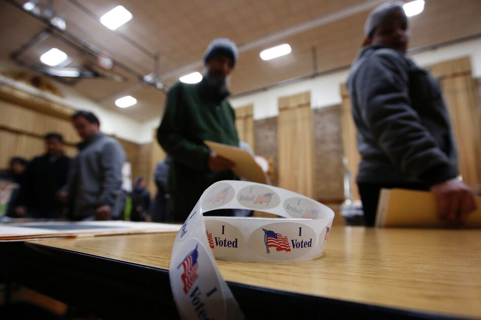 """A roll of """"I Voted"""" stickers sits on a table at an elementary school during the U.S. presidential election on November 8, 2016 in Dearborn, Mich. (Jeff Kowalsky/AFP/Getty Images)"""