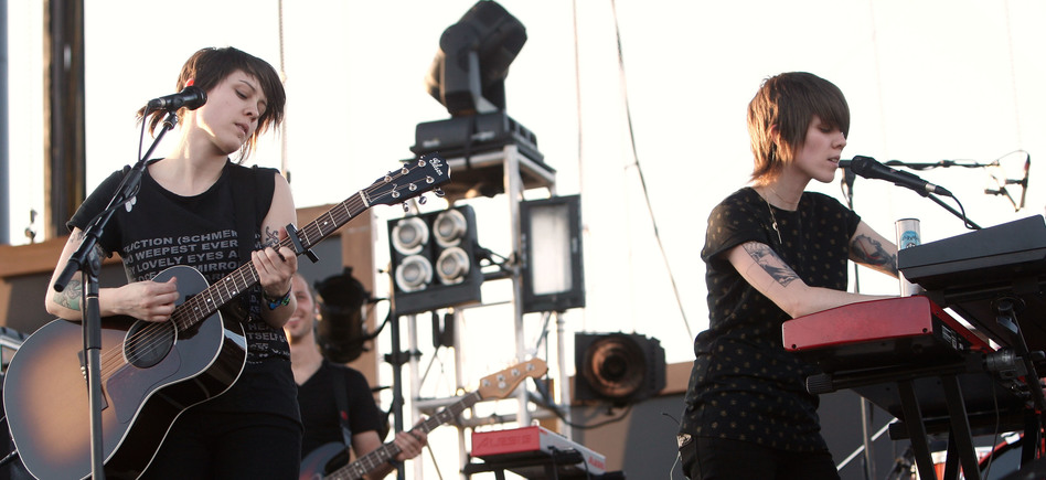 Tegan (left) and Sara Quin perform at Coachella in 2008, following the release of the duo's fifth album, <em>The Con</em>. Tegan and Sara are celebrating the 10th anniversary of <em>The Con </em>with a tour and an album of covers performed by musicians influenced by the original album. (Kevin Winter/Getty Images)