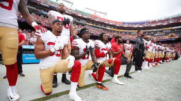 Members of the San Francisco 49ers kneel with teammates during the anthem, prior to the game against the Washington Redskins at FedEx Field on October 15, 2017 in Landover, Maryland.