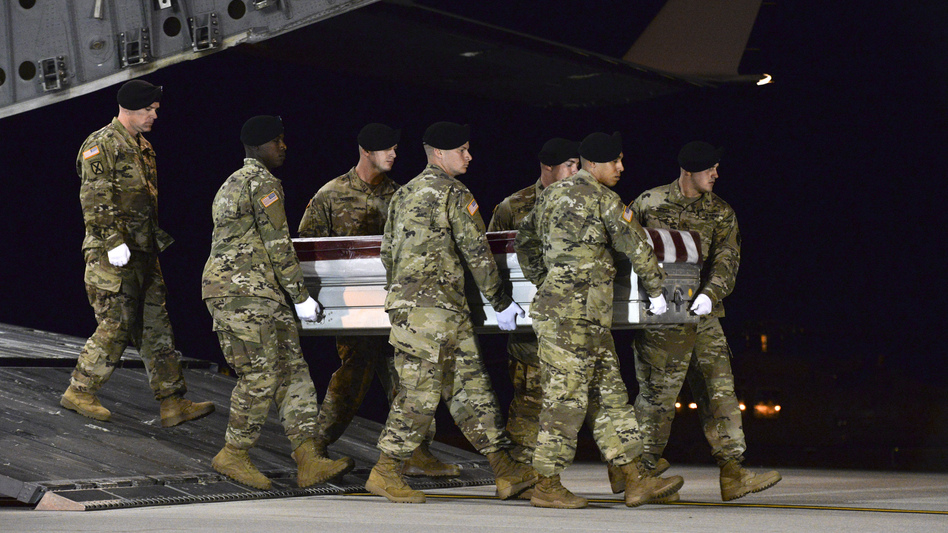 A U.S. Army team transfers the remains of Staff Sgt. Dustin Wright, 29, of Lyons, Ga., at Dover Air Force Base, Del., on Oct. 5. Wright was one of four U.S. troops killed in an ambush in Niger. U.S. forces work with many African militaries. While the Americans are advising and assisting in most cases, they also travel into the field, where they can face combat. (Staff Sgt. Aaron J. Jenne/U.S. Air Force via AP)