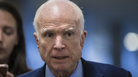 Sen John McCain, R-Ariz., returns to his office after a series of votes at the Capitol in Washington on Thursday.