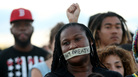 "Demonstrators in Miami stand with tape reading, "" I Can't Breathe,"" in 2014. The protest occurred after a grand jury in New York City declined to indict the police officers involved Eric Garner's death."