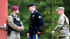 U.S. Army Sgt. Bowe Bergdahl (center) is escorted to the military courthouse at Fort Bragg, N.C., on Oct. 16, the day he pleaded guilty to desertion and misbehavior before the enemy.
