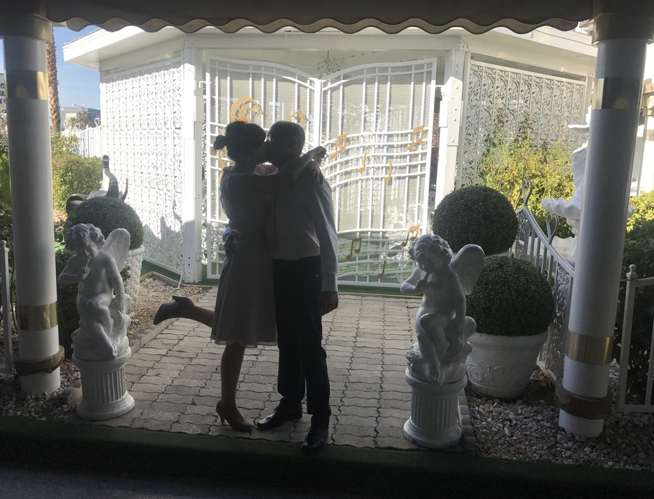 Agnes Kolodziaj and Lucas Pawelek kiss in front of the Gazebo at A Little White Wedding Chapel. The Polish couple started planning their Las Vegas nuptials six months ago. (Leila Fadel /NPR)