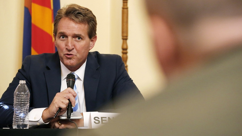 Sen. Jeff Flake, left, R-Ariz., who announced he will not run for reelection on Tuesday, appears at a hearing on border security in Arizona in 2015. (Ross D. Franklin/AP)
