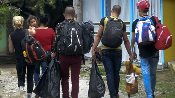 Cuban migrants who arrived in northwestern Colombia set out to cross illegally to Panama through the jungle in August 2016.