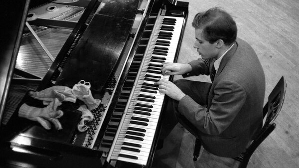 Glenn Gould, with his gloves and wrist-warmers, in the Columbia Records studio where he recorded Bach
