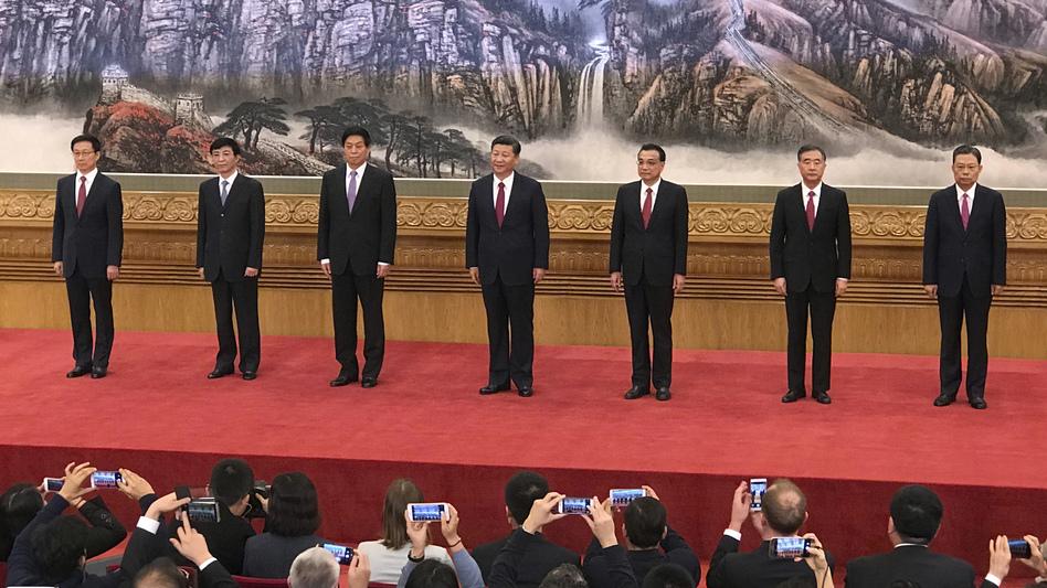 New members of the Politburo Standing Committee (from left) Han Zheng, Wang Huning, Li Zhanshu, Xi Jinping, Li Keqiang, Wang Yang and Zhao Leji stand together at Beijing's Great Hall of the People on Wednesday. (Ng Han Guan/AP)