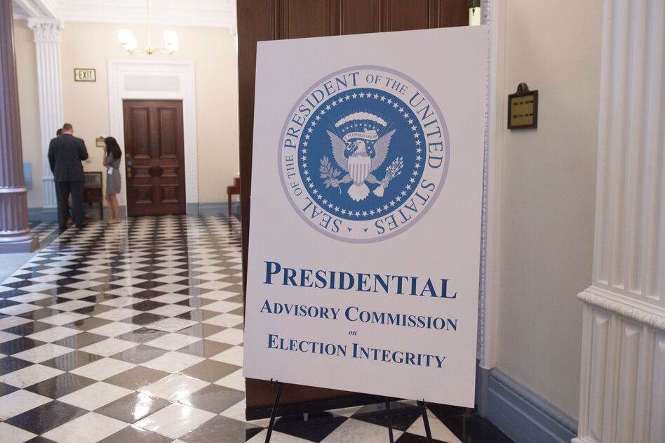 A sign appears outside the room where the first meeting of the Presidential Advisory Commission on Election Integrity in the Eisenhower Executive Office Building in Washington, DC, July 19, 2017. (Saul Loeb/AFP/Getty Images)