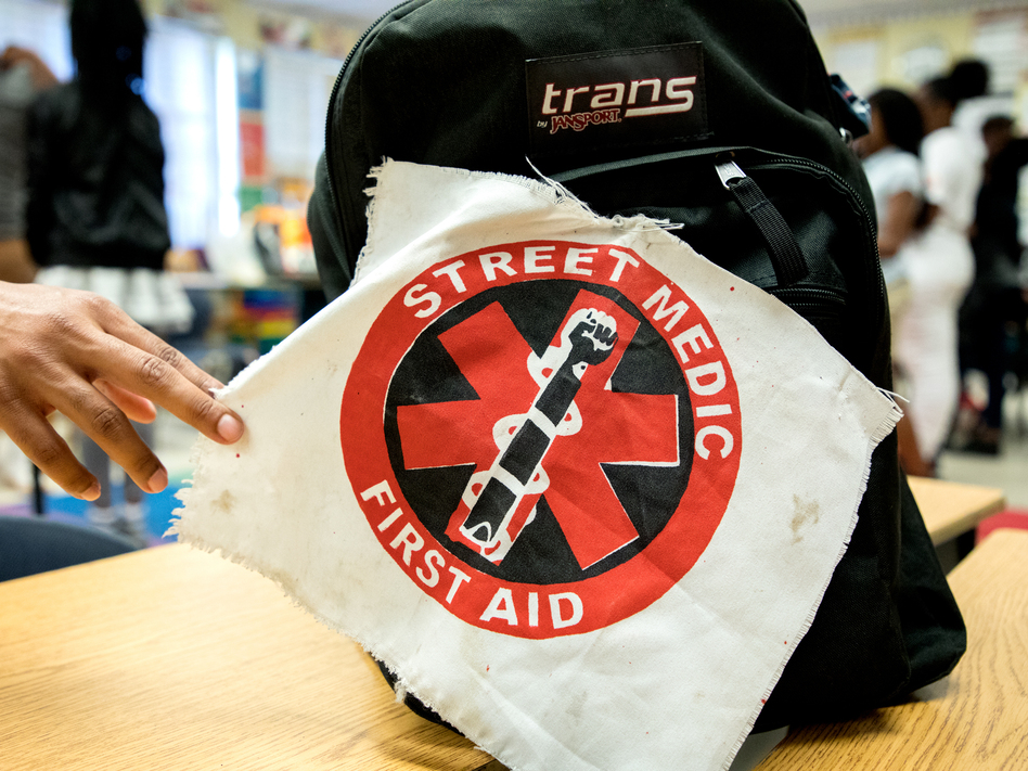 A street medic patch marks a first aid kit at a UMedics workshop in Chicago's Bronzeville neighborhood. The group trains everyday people to care for shooting victims, control a chaotic scene and talk to cops and paramedics. (Andrew Gill/WBEZ)