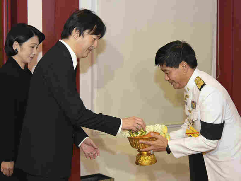 Japan's Prince Akishino and Princess Kiko are greeted by Thai Privy Councilor Charunthada Karnasuta as they arrive to attend the funeral procession and royal cremation ceremony of late Thai King Bhumibol Adulyadej. The image was provided by the Thai Foreign Ministry.